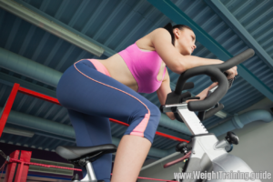 Lady on exercise bike