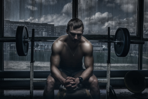 Man sitting on adjustable bench with barbell